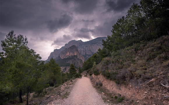 Mountain Trail and Dark Clouds
